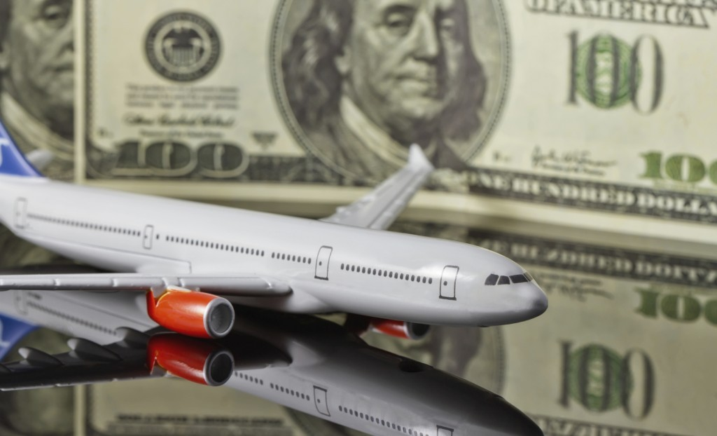 Concept :rise of freight and passenger traffic in the world. Figure the plane on the background of hundred-dollar bills.