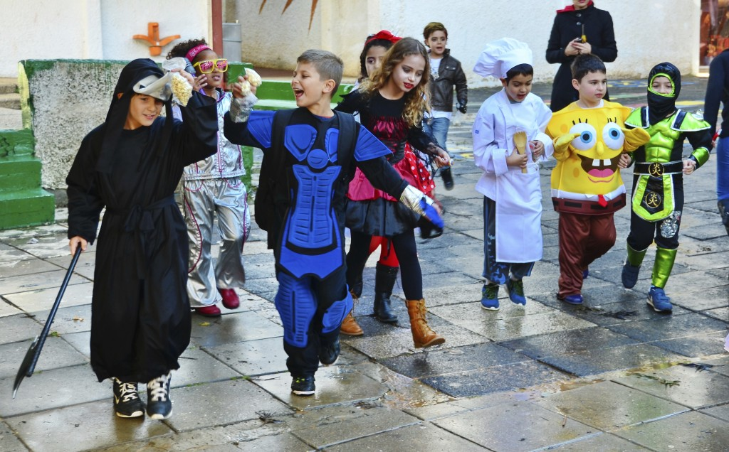 KFAR SABA, ISRAEL - MAR 15, 2014: Unidentified children aged 7-8 dress up for Purim. Purim is celebrated in Israel secular communities by dressing up in special custumes, music, and festivals.