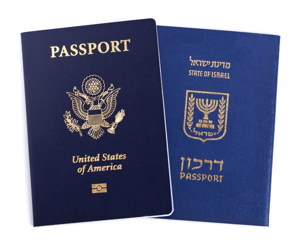 USA and Israeli passports isolated on white background.