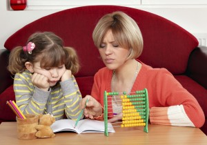 unhappy daughter and mother doing homework