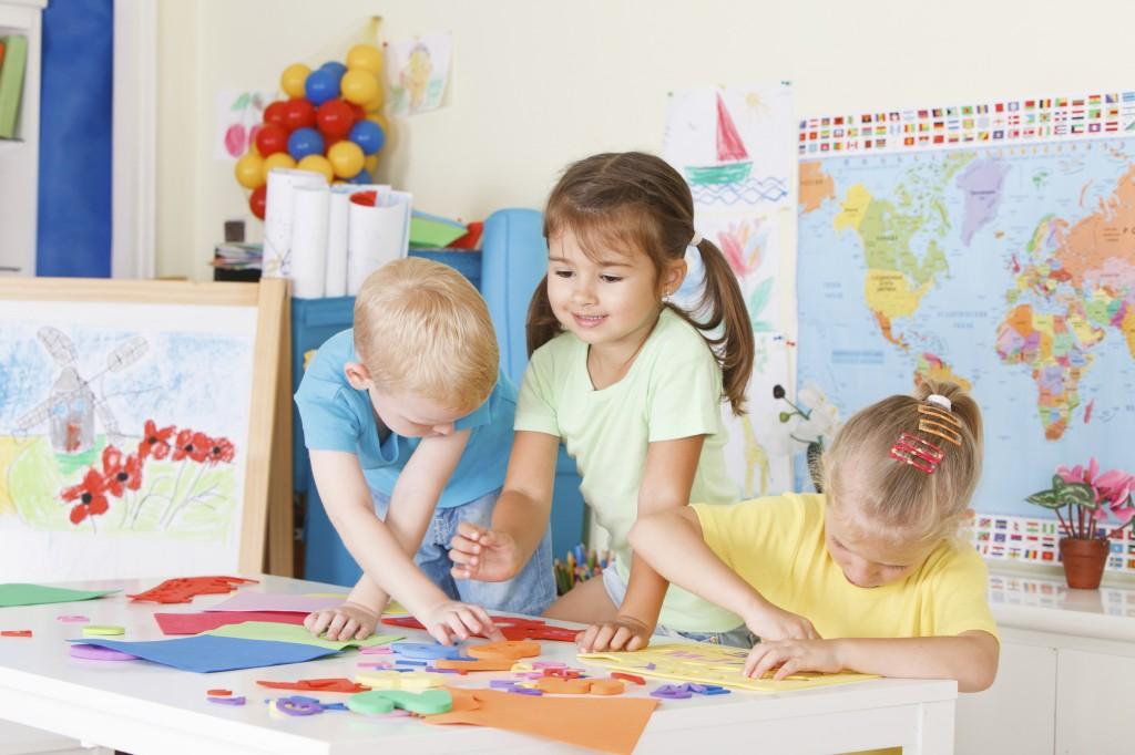 Three preschoolers in the classroom